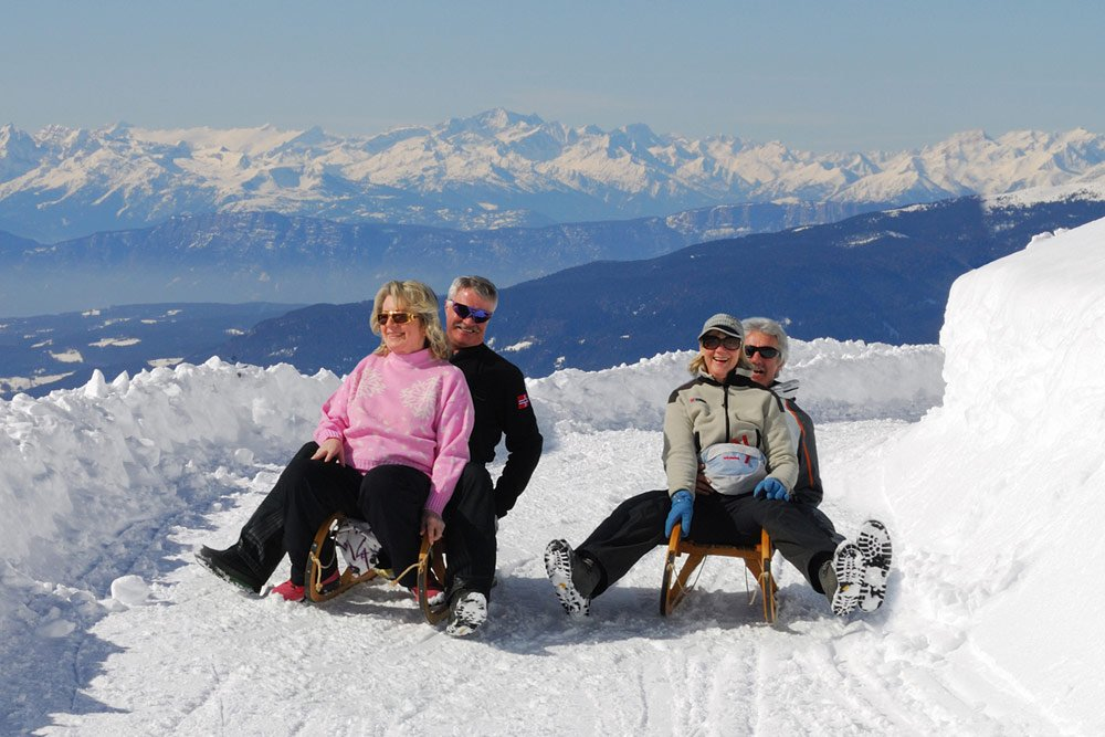Toboggan fun and cross-country skiing during your ski vacation in Bressanone